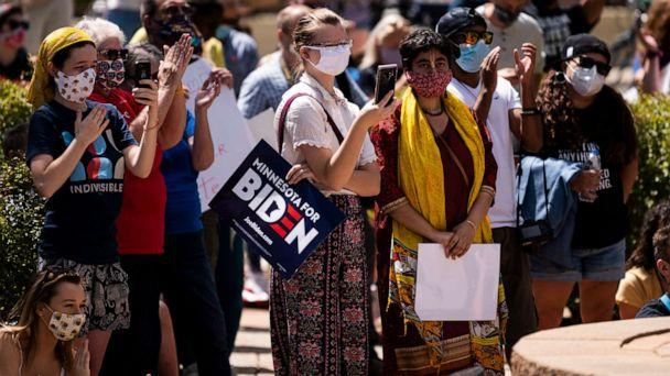 PHOTO: A woman holds a sign that reads 'Minnesota for Biden' as protesters gather in downtown while President Donald Trump makes a campaign stop at Mankato Regional Airport on Aug. 17, 2020, in Mankato, Minn. (Stephen Maturen/Getty Images, FILE)