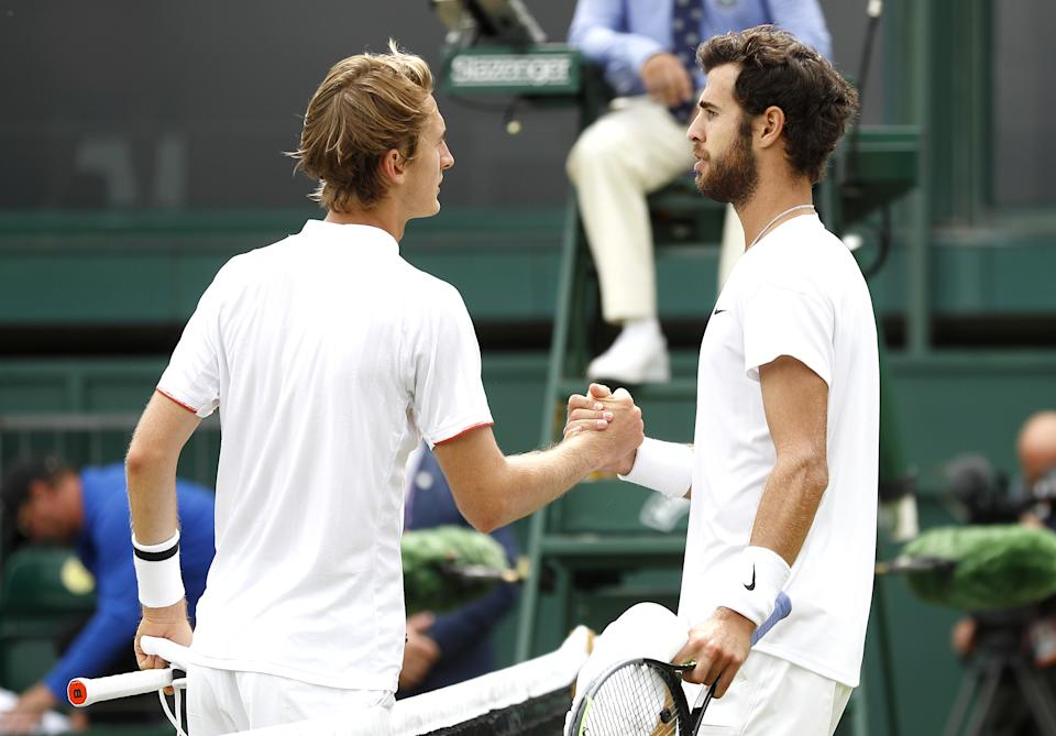 Karen Khanchanov (pictured right) greets Sebastian Korda (pictured left) and shakes hands after victory at Wimbledon.