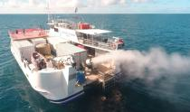 Plume from sprayer jets on a vessel is seen during the second field trial at Broadhurst Reef on the Great Barrier Reef
