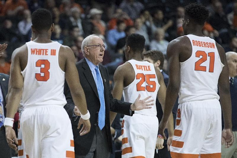 Syracuse head coach Jim Boeheim, second from left, gestures as his team comes in to the bench during a time out in the second half of an NCAA college basketball game against the Miami in the Atlantic Coast Conference tournament, Wednesday, March 8, 2017, in New York. Miami won 62-57. (AP Photo/Mary Altaffer)