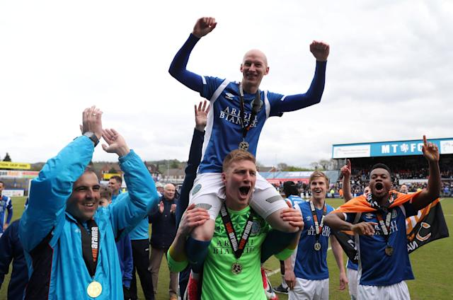 Soccer Football - National League - Macclesfield Town v Dagenham & Redbridge - Moss Rose, Macclesfield, Britain - April 28, 2018 Macclesfield Town's Danny Whitaker celebrates winning the league with team mates Action Images/Peter Cziborra