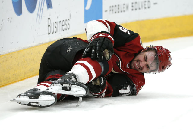 Arizona Coyotes defenseman Kyle Capobianco reacts after getting checked during the third period of the team's NHL hockey game against the Columbus Blue Jackets, Thursday, Feb. 7, 2019, in Glendale, Ariz. Capobianco left the game.Columbus won 4-2. (AP Photo/Rick Scuteri)
