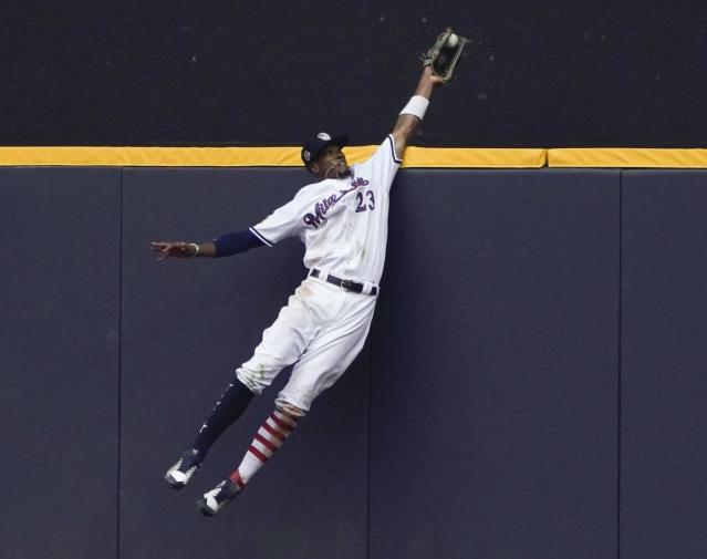 Milwaukee Brewers' outfielder Keon Broxton makes a leaping catch to rob the Twins Brian Dozier of a ninth-inning home run. (AP)