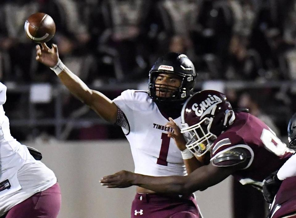 Mansfield Timberview quarterback Simeon Evans left, throws down the field as he is hit by Ennis's Deryous Stokes in the second quater of their Division 2 Region 2-5A Area Play-off football game Friday, December 18, 2020 at the Midlothian ISD Mult-Purpose Stadium in Midlothian, Texas. Timberview won 42-28. Special/Bob Haynes