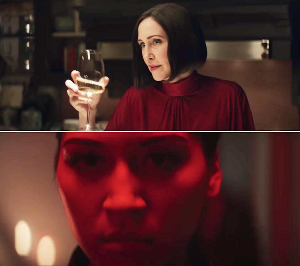 Vera holding a wine glass and Maya in close-up with red light
