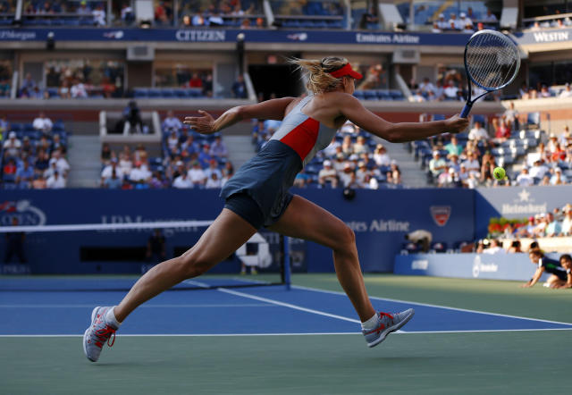 Maria Sharapova, of Russia, chases down a shot against Alexandra Dulgheru, of Romania, during the second round of the 2014 U.S. Open tennis tournament, Wednesday, Aug. 27, 2014, in New York. (AP Photo/Matt Rourke)