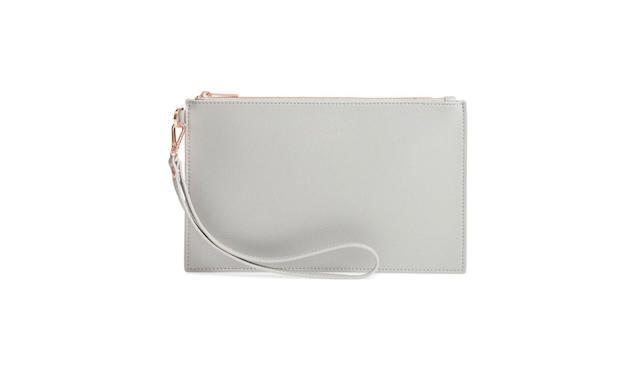 "<p>Faux-leather pouch, $59, <a href=""https://shop.nordstrom.com/s/ted-baker-london-top-zip-faux-leather-pouch/4746832"" rel=""nofollow noopener"" target=""_blank"" data-ylk=""slk:nordstrom.com"" class=""link rapid-noclick-resp"">nordstrom.com</a> </p>"