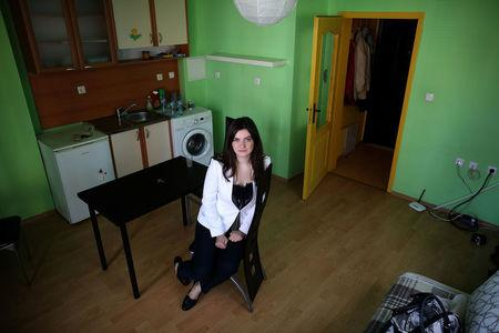 Bulgarian Teodora Yolcheva, 31, a public relations professional, poses for a picture in her empty apartment in preparation for her departure to London, in Sofia, Bulgaria, March 22, 2017. Picture taken March 22, 2017.  REUTERS/Stoyan Nenov