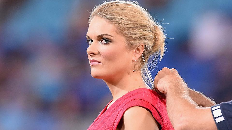 Seen here, Erin Molan getting mic'd up for her rugby league presenting duties.