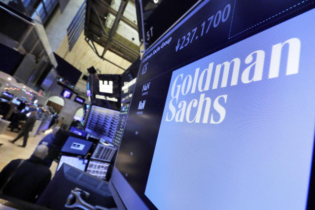 The logo for Goldman Sachs appears above a trading post on the floor of the New York Stock Exchange. (Richard Drew/AP)