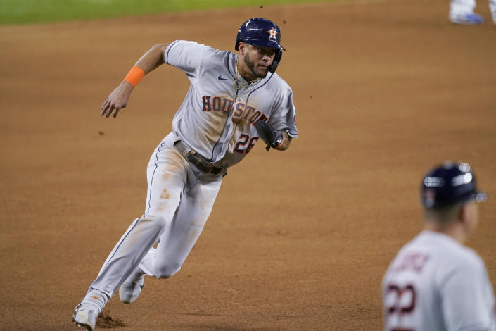 Houston Astros' Jose Siri advances to third on a wild pitch during the fifth inning of the team's baseball game against the Texas Rangers in Arlington, Texas, Tuesday, Sept. 14, 2021. (AP Photo/Tony Gutierrez)