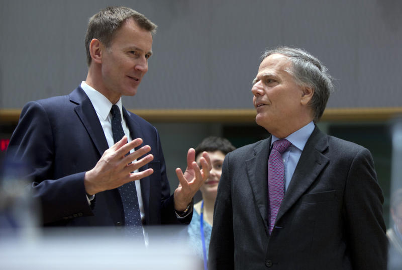 British Foreign Secretary Jeremy Hunt, left, speaks with Italian Foreign Minister Enzo Moavero Milanesi during a meeting of EU foreign ministers at the EU Council building in Brussels, Monday, March 18, 2019. EU foreign ministers hold talks with their Chinese counterpart as the bloc seeks to establish a new strategic balance with the Asian economic giant. (AP Photo/Virginia Mayo)