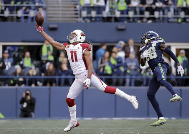 Arizona Cardinals' Larry Fitzgerald (11) just misses a catch in front of Seattle Seahawks' Justin Coleman during the first half of an NFL football game, Sunday, Dec. 30, 2018, in Seattle. (AP Photo/Ted S. Warren)