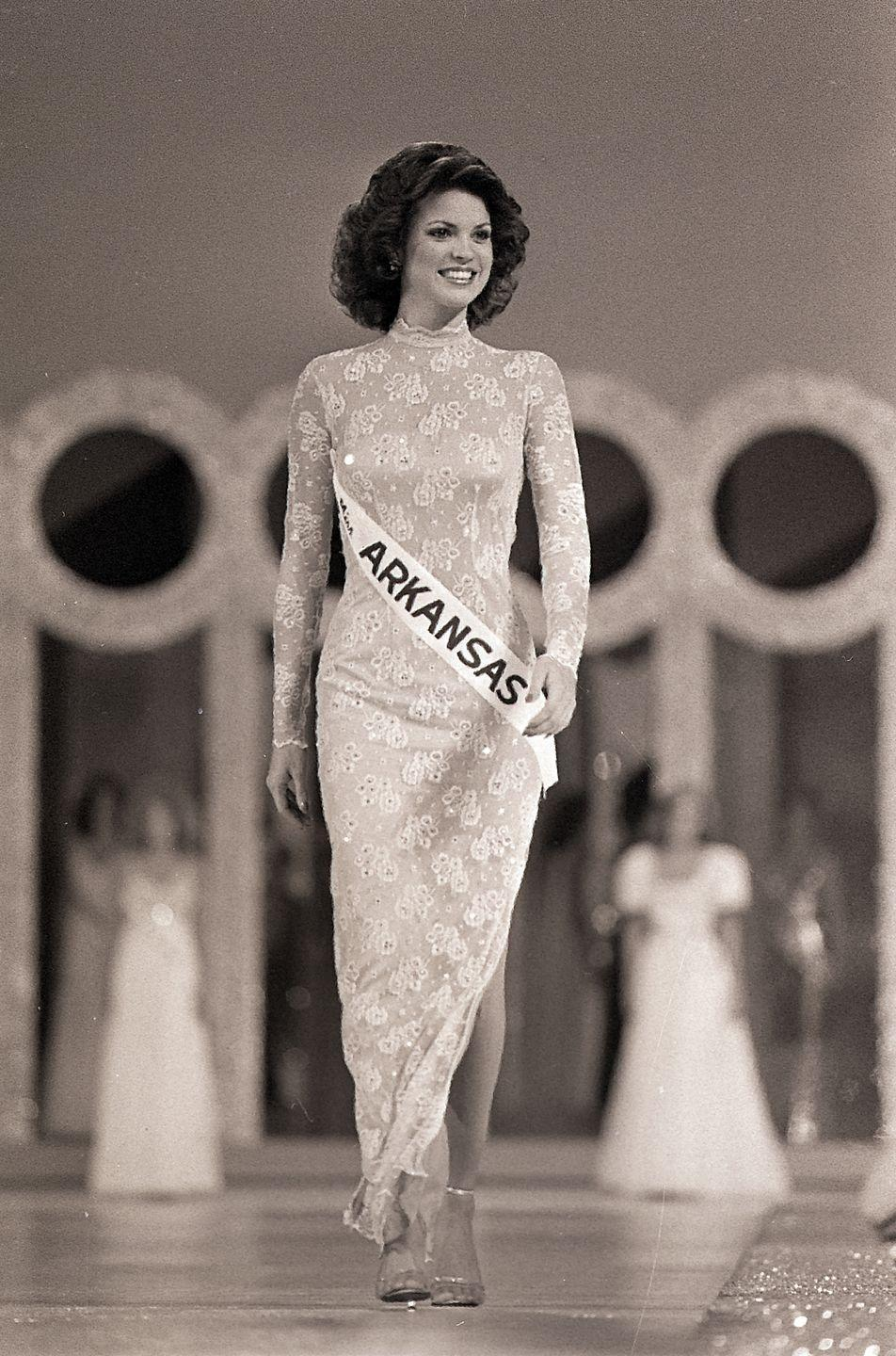 <p>With a form-fitting dress and coiffed '80s hair, Miss Arkansas, Elizabeth Ward, took home the 1982 title for Miss America. Her dress, which leaned on the subtle side, was a departure from the glitz and glam of previous winners.</p>