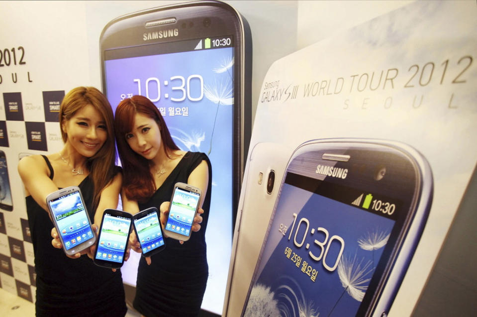 <p> In this photo released by Samsung Electronics Co., models pose with Samsung Electronics' newest smartphone Galaxy S III during its world tour in Seoul, South Korea, Monday, June 25, 2012. Samsung Electronics, the world's top mobile phone maker, said Monday it expects global sales of the latest Galaxy smartphone to surpass 10 million in July even as it struggles to keep up with demand because of component shortages. (AP Photo/Samsung Electronics) NO SALES </p>