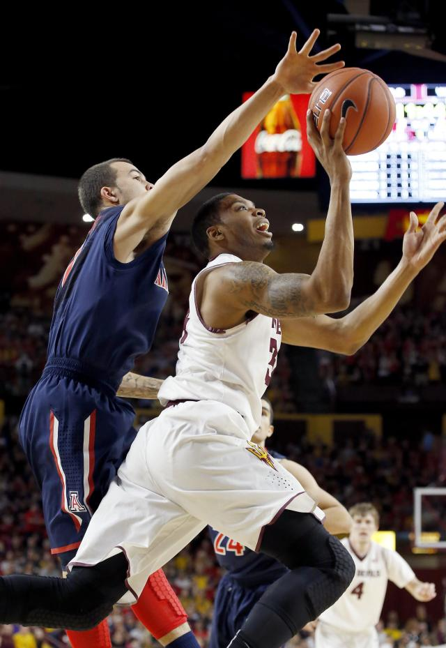 Arizona State's Jermaine Marshall, right, has his shot blocked by Arizona's Gabe York, left, during the first half of an NCAA college basketball game on Friday, Feb. 14, 2014, in Tempe, Ariz. (AP Photo/Ross D. Franklin)