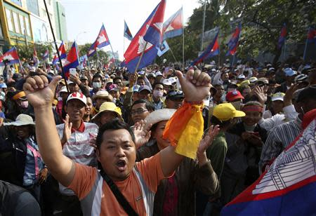 Supporters of the opposition Cambodia National Rescue Party (CNRP) march along a street during a protest in Phnom Penh