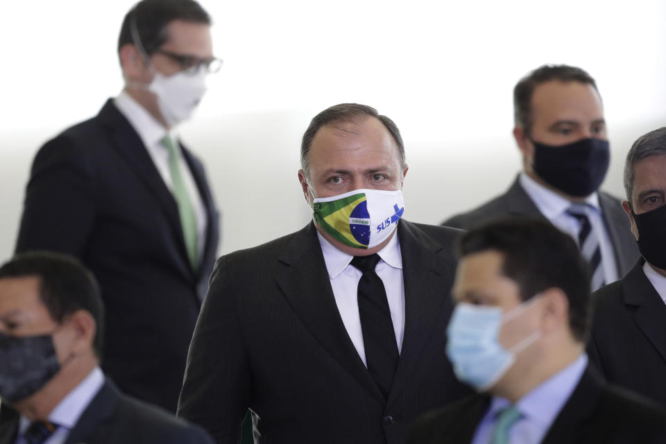 Brazil's Health Minister Gen. Eduardo Pazuelo, center, arrives to attend a ceremony at the Planalto Presidential Palace, in Brasilia, Brazil, Wednesday, Sept. 16, 2020. After almost four months overseeing the COVID-19 response as interim health minister, Gen. Eduardo Pazuello will finally be made a full minister. (AP Photo/Eraldo Peres)