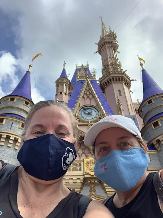 Sisters Mary Griffin and Leslie Shinault of Rockledge, Florida, masked up and headed for a resort weekend at Walt Disney World for the reopening of Magic Kingdom.