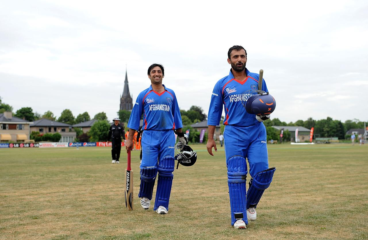 VOORBURG, NETHERLANDS - JULY 07:  Nowroz Mangal (R) and Asghar Salakhail of Afghanistan leave the field after beating Netherlands during the ICC World Cricket League Division One match between Netherlands and Afghanistan at the VCC Voorburg on July 7, 2010 in Voorburg, Netherlands.  (Photo by Christopher Lee/Getty Images)