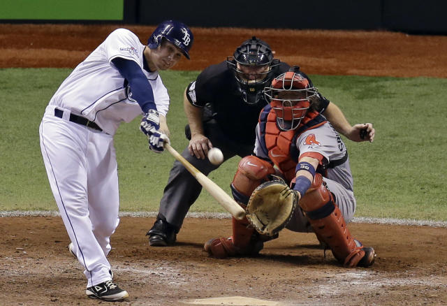 Tampa Bay Rays' Jose Lobaton hits a home run in front of Boston Red Sox catcher Jarrod Saltalamacchia in the ninth inning to win Game 3 of an American League baseball division series in St. Petersburg, Fla., Monday, Oct. 7, 2013. Tampa Bay Rays won 5-4. (AP Photo/John Raoux)
