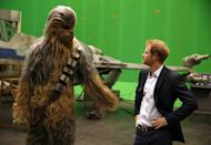 <p>Harry meets Chewbacca during a tour of the <em>Star Wars</em> set at Pinewood studios.</p>