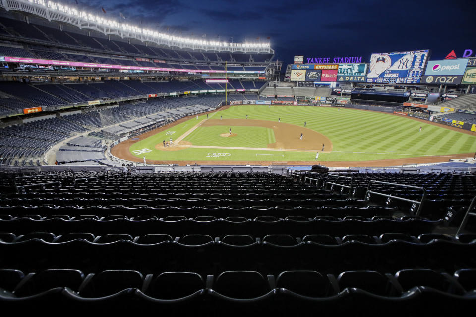 Stands remain empty of spectators in the fourth inning of a baseball game between the New York Yankees and the Boston Red Sox, Saturday, Aug. 1, 2020, in New York. (AP Photo/John Minchillo)