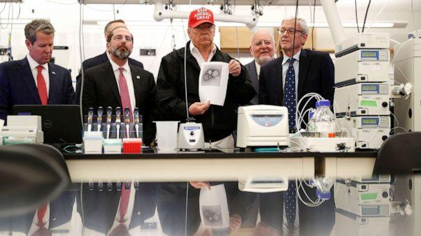 PHOTO: President Donald Trump displays a photo of COVID-19 beside Georgia Governor Brian Kemp, HHS Secretary Alex Azar and CDC Associate Director for Laboratory Science and Safety Steve Monroe, at the Center for Disease Control in Atlanta, March 6, 2020. (Tom Brenner/Reuters)