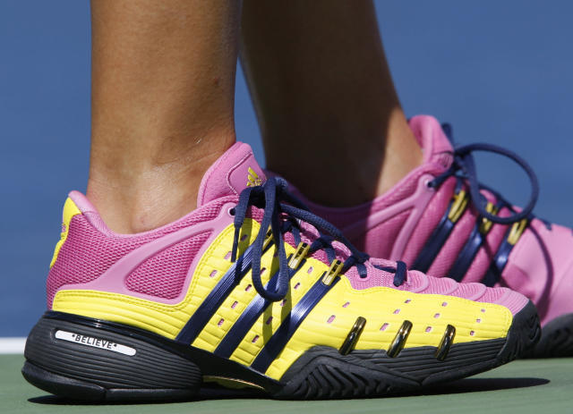 """FILE - In this Sept. 3, 2009, file photo, Melanie Oudin, of the United States, wears shoes imprinted with """"Believe"""" during her match against Elena Dementieva, of Russia, during the second round of the U.S. Open tennis tournament in New York. A decade after that magical and memorable Grand Slam stay in New York, which followed a just-as-surprising run from qualifier to the fourth round at Wimbledon--like another American teen, Coco Gauff, did to much more fanfare this summer--Oudin is retired from the WTA tour, teaching kids the sport she loves and hoping to coach a pro one day. (AP Photo/Kathy Willens, File)"""
