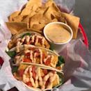 """<p>If you're going to Louisiana, you'll definitely want to try these cajun and Mexican fusion tacos from <a href=""""https://couyons.com/"""" rel=""""nofollow noopener"""" target=""""_blank"""" data-ylk=""""slk:Cou-Yon's Cajun Bar-B-Q"""" class=""""link rapid-noclick-resp"""">Cou-Yon's Cajun Bar-B-Q</a>. And who says you can't order some cornbread as a side for tacos?</p><p><em>Check out <a href=""""https://www.facebook.com/Couyons/"""" rel=""""nofollow noopener"""" target=""""_blank"""" data-ylk=""""slk:Cou-Yon's Cajun Bar-B-Q on Facebook"""" class=""""link rapid-noclick-resp"""">Cou-Yon's Cajun Bar-B-Q on Facebook</a>.</em></p>"""
