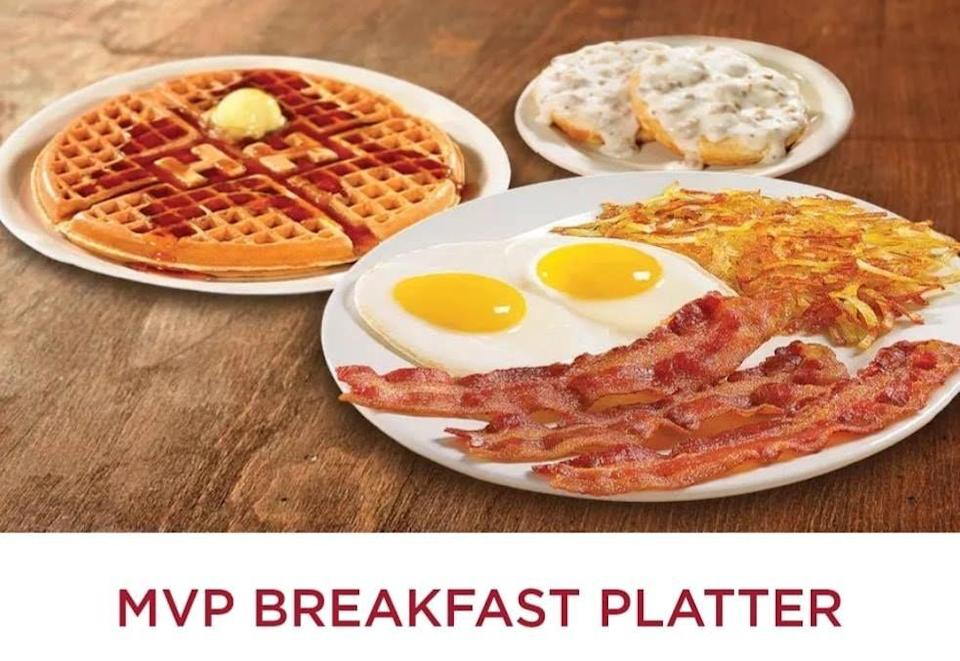 """<p>With two eggs, hash browns, a waffle, bacon or sausage, grits, AND toast or a biscuit with sausage gravy, Huddle House's MVP Breakfast Platter isn't just the menu's most valuable player, it's the whole team. <a href=""""https://www.huddlehousefranchising.com/blog/5-top-menu-items-that-bring-in-hh-customers/"""" rel=""""nofollow noopener"""" target=""""_blank"""" data-ylk=""""slk:The chain says"""" class=""""link rapid-noclick-resp"""">The chain says</a> this pick is its top-selling item, and that it's for """"the serious breakfast aficionado."""" You can say that again—you have to be a fan of all the breakfast foods, not to mention very hungry, to get through this one. We do love what a match it is for the indecisive ones among us.</p>"""