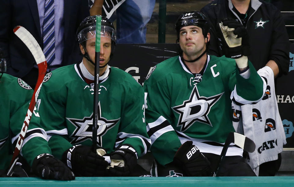 Dallas Stars' Jamie Benn (14) acknowledges the fans' cheers after scoring his third goal of the game, as he sits next to Patrik Nemeth during the third period of an NHL hockey game against the Nashville Predators, Saturday, April, 11, 2015, in Dallas. (AP Photo/Mike Stone)