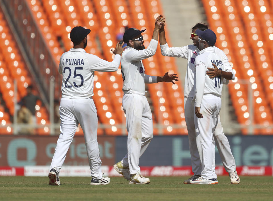 India's Axar Patel, second right, celebrates with teammates the dismissal of England's Dominic Bess during the third day of fourth cricket test match between India and England at Narendra Modi Stadium in Ahmedabad, India, Saturday, March 6, 2021. (AP Photo/Aijaz Rahi)