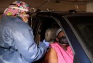 Detroit resident receives a COVID vaccination in the TCF Center garage in Detroit, Michigan
