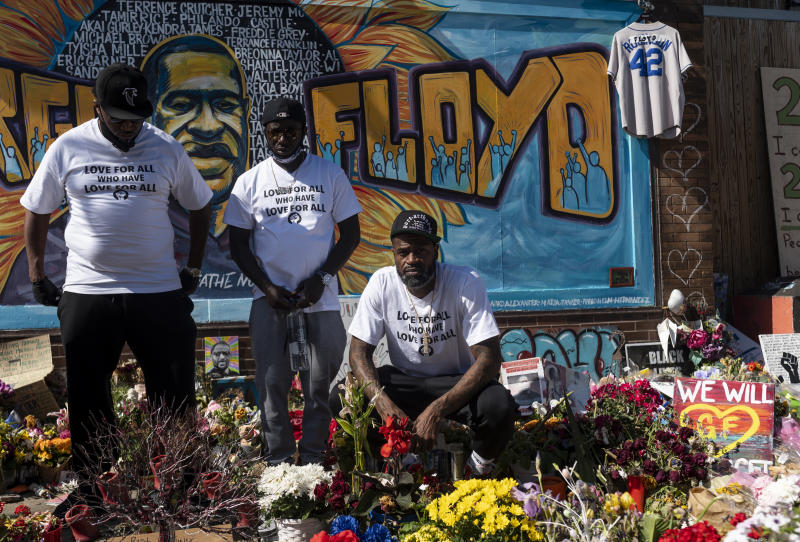 Former NBA player Stephen Jackson (right), a friend of George Floyd's, poses for a photograph at a memorial for Floyd on Wednesday. (Stephen Maturen/Getty Images)