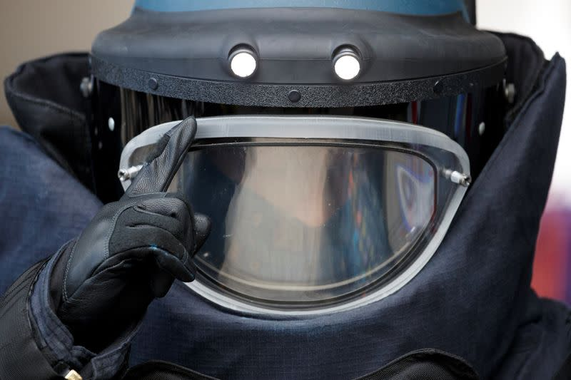 EOD officer wears protective suit during media tour of EOD depot of Hong Kong police, in Hong Kong