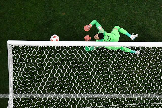 <p>Croatia's goalkeeper Danijel Subasic concedes from a free-kick during the Russia 2018 World Cup semi-final football match between Croatia and England at the Luzhniki Stadium in Moscow on July 11, 2018. (Photo by François-Xavier MARIT / AFP) </p>