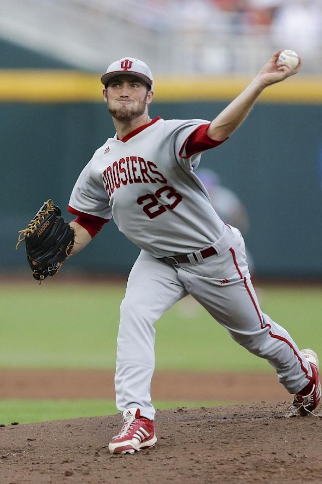 FILE - In this June 15, 2013 file photo, Indiana starting pitcher Joey DeNato delivers against Louisville in the first inning of an NCAA College World Series game in Omaha, Neb. DeNato leads the Big Ten's top pitching staff with an 8-1 record and 2.12 ERA. (AP Photo/Nati Harnik)