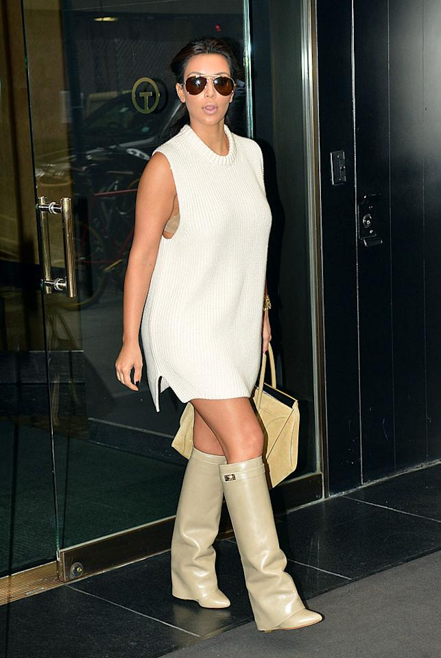 "Wearing an unshapely, sleeveless sweater dress and clunky, nude-hued, knee-high boots, <a target=""_blank"" href=""http://omg.yahoo.com/kim-kardashian/"">Kim Kardashian</a> hit the streets of NYC on Thursday following an appearance on ""The View."" What do you make of the reality TV titan's potato sack-like ensemble? Ridiculous, right? (9/6/2012)<br><br><a target=""_blank"" href=""http://bit.ly/lifeontheMlist"">Follow What Were They Thinking?! creator, Matt Whitfield, on Twitter!</a>"