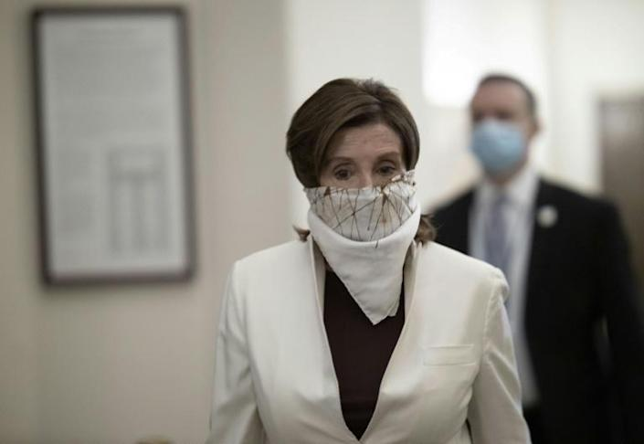 Democratic Speaker of the House Nancy Pelosi wore a face covering as she arrived on Capitol Hill to vote on the latest US stimulus bill (AFP Photo/WIN MCNAMEE)