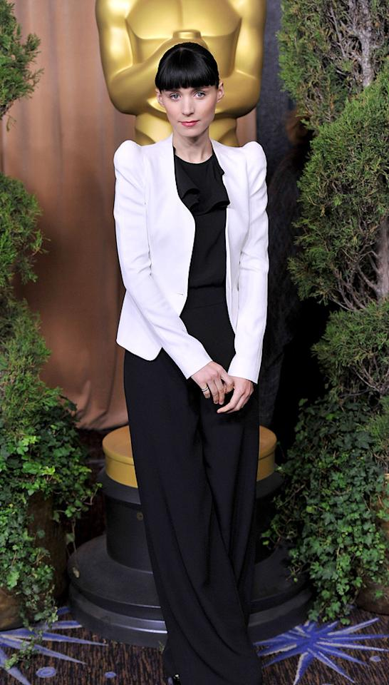 "Rooney Mara (""The Girl with the Dragon Tattoo"") opted for a color-blocked look, topping her dark ASOS jumpsuit with a white, shoulder pad-enhanced Thierry Mugler jacket."