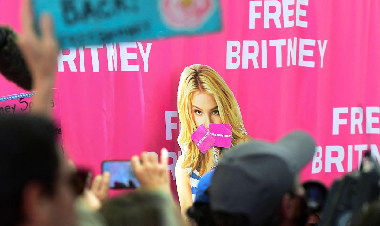 Fans and supporters of Britney Spears gather outside the County Courthouse in Los Angeles, California on June 23, 2021, during a scheduled hearing in Britney Spears' conservatorship case. - Pop singer Britney Spears urged a US judge on June 23, to end a controversial guardianship that has given her father control over her affairs since 2008.