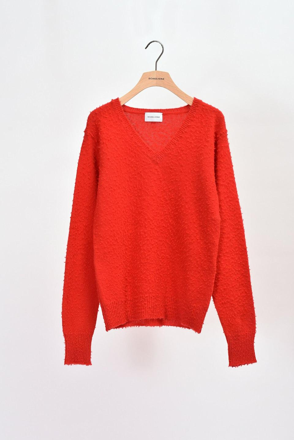 """<p><span>Scaglione Slim Red Casentino V-Neck</span> ($272)</p> <p>""""I love gifting people things with a story. I just got one of my traveller friends this sweater because of the Panno Casentino was invented in the 1800s in Tuscany for durability on the road. Audrey Hepburn also wears an amazing coat of this material, the orange one in Breakfast at Tiffany's!"""" - NR</p>"""