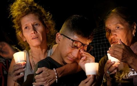 A candlelight vigil is held for the victims of a fatal shooting at the First Baptist Church of Sutherland Springs - Credit: AP