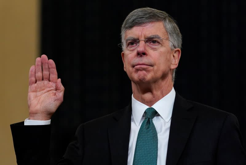 FILE PHOTO: Ambassador Bill Taylor sworn in to testify as House Intelligence Committee holds hearing on Trump impeachment inquiry on Capitol Hill in Washington