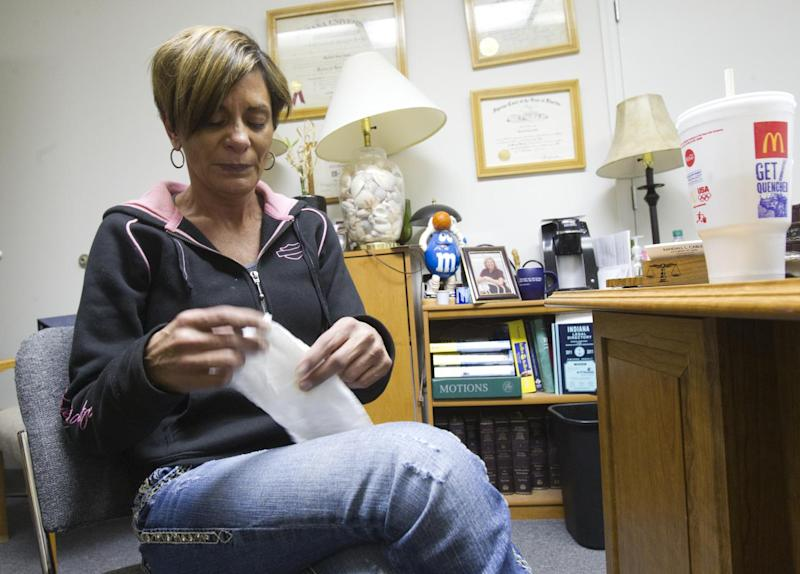 Monserrate Shirley, talks with a reporter and photographer about her home in Indianapolis, Tuesday, Nov. 13, 2012. Shirley's home was one of two of the main homes destroyed by an explosion of unknown origin on Saturday night. An owner of the house believed to be at the center of the explosion has said the home's furnace had been having problems, but his estranged wife, Monserrate Shirley, said the furnace was fine. (AP Photo/The Star, Robert Scheer)