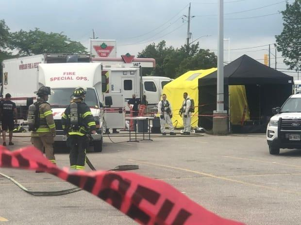 Windsor Police investigate a potentially hazardous material found inside a vehicle in a Canadian Tire parking lot on Wednesday July 13. (Jacob Barker/CBC - image credit)
