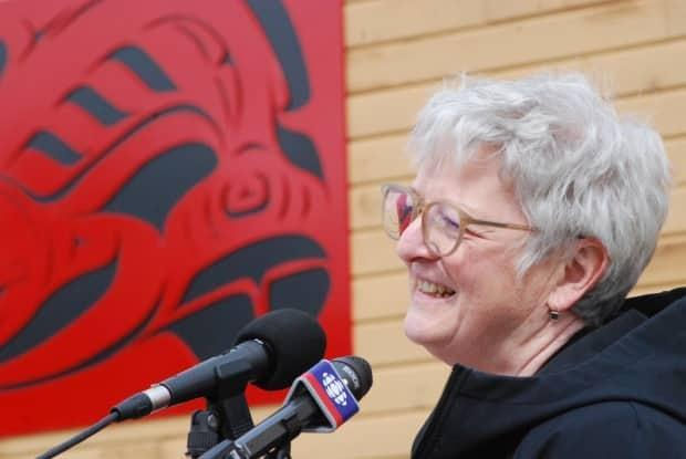 Karen Barnes, former Yukon College president and now president emerita of Yukon University, speaks at the unveiling of the new artwork, which features a formline salmon from Selkirk First Nation artist Eugene Alfred.