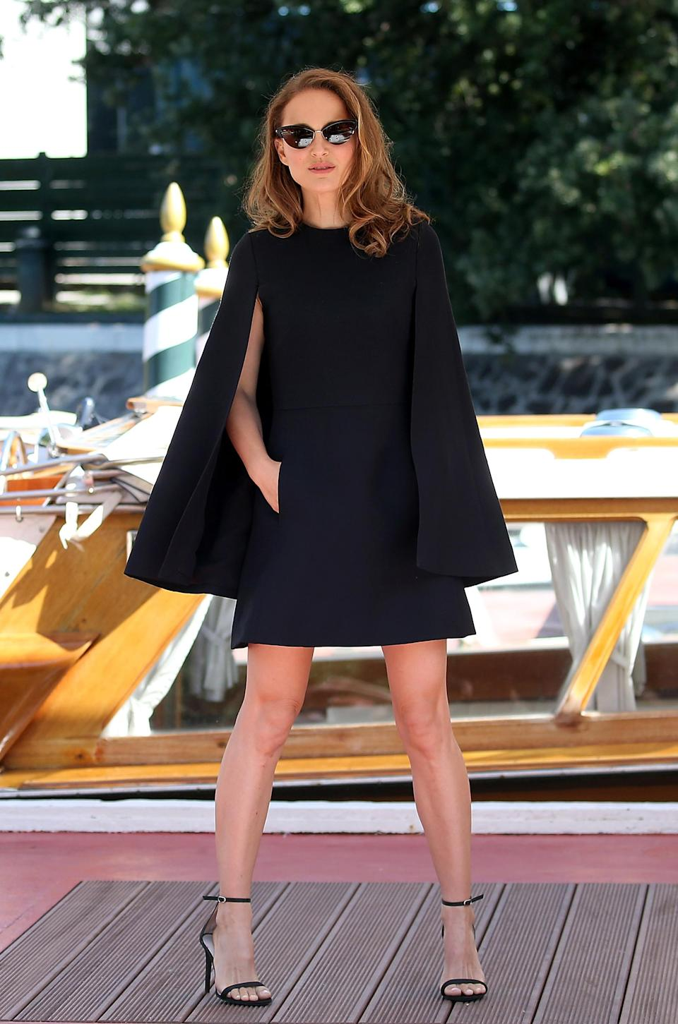 <p>The Oscar-winning star looked as chic as ever in a navy Dior dress with cape. <em>[Photo: Getty]</em> </p>