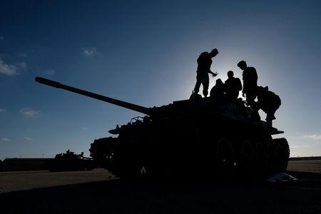 FILE PHOTO: Members of Libyan National Army (LNA) commanded by Khalifa Haftar, get ready before heading out of Benghazi to reinforce the troops advancing to Tripoli, in Benghazi